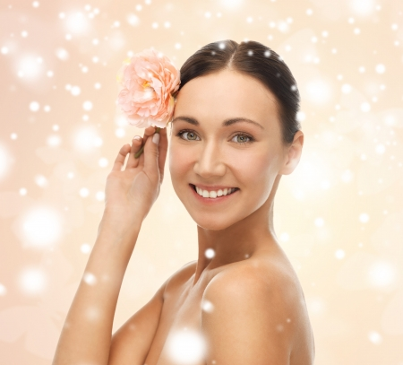 health and beauty concept - relaxed woman with rose flower photo