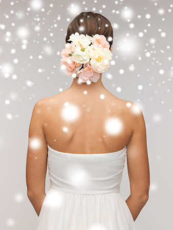 valentines day, bridal, wedding, christmas, x-mas, winter, happiness concept - woman with flowers in her head photo