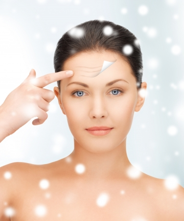 dry skin: health and beauty concept - beautiful woman face Stock Photo