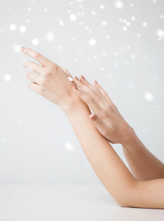 health and beauty concept - female soft skin hands with creme photo