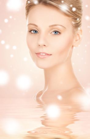 health, spa, beauty concept - face and shoulders of beautiful woman photo