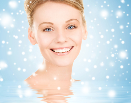 health, spa, beauty concept - face of happy beautiful woman photo