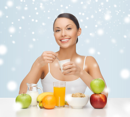 food, nutrition, slimming, diet concept - woman eating healthy breakfast photo