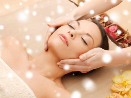 spa resort: health and beauty concept - woman in spa salon lying on the massage desk