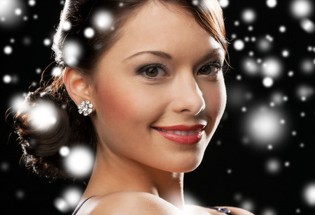 luxury, vip, nightlife, party, christmas, x-mas, new year's eve concept - beautiful woman in evening dress wearing diamond earrings Stock Photo - 22773966