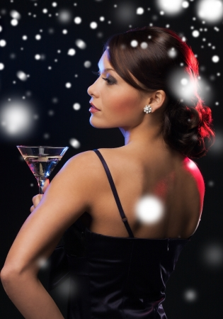 new: luxury, vip, nightlife, party, christmas, x-mas, new years eve concept - beautiful woman in evening dress with cocktail Stock Photo