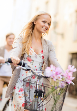 summer holidays, bikes, love, relationship and dating concept - couple with bicycles in the city photo