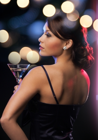 party dress: luxury, vip, nightlife, party concept - beautiful woman in evening dress with cocktail