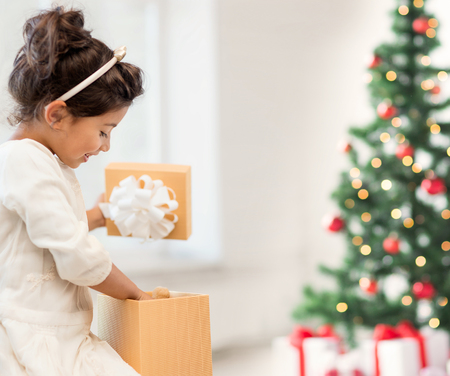 holidays, presents, christmas, x-mas concept - happy child girl with gift box photo
