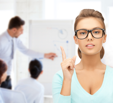 opthalmology: education, vision, optics concept - attractive student or teacher wearing glasses in college