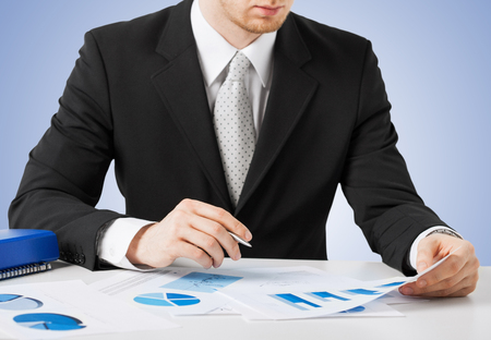 office, buisness, legal concept - businessman working and signing with papers photo