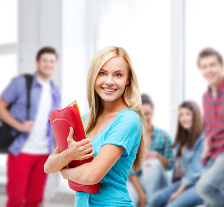 high school students: school and education concept - smiling student with folders