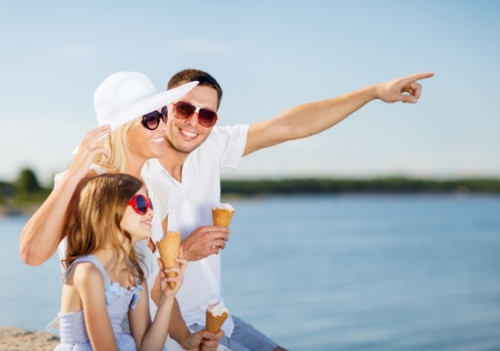 woman with ice cream: summer holidays, celebration, children and people concept - happy family eating ice cream