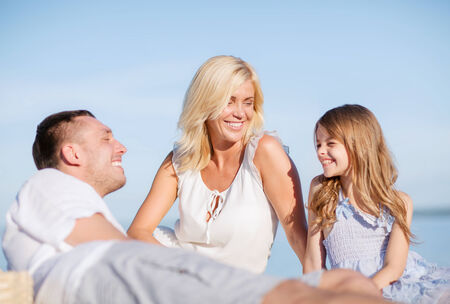 summer holidays, children and people concept - happy family having a picnic photo