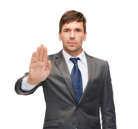 business and office, ban, veto, warning concept - attractive buisnessman making stop gesture photo