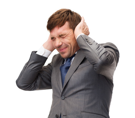 loud noise: business and office, stress, problem, crisis, loud noise concept - stressed buisnessman or teacher closing ears