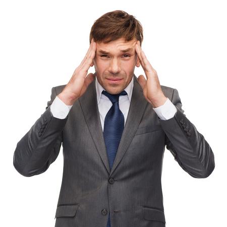 business and office, stress, problem, crisis concept - stressed buisnessman or teacher having headache photo