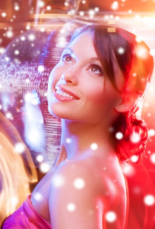 luxury, vip, nightlife, party, christmas, x-mas, new years eve concept - beautiful woman in evening dress with disco ball