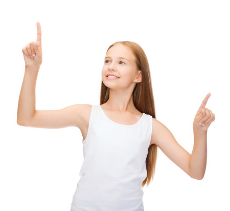 shirt design concept - smiling teenage girl in blank white shirt pointing to something or pressing imaginary button photo