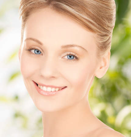 health and beauty, eco, bio, nature concept - face of beautiful woman with updo hair photo