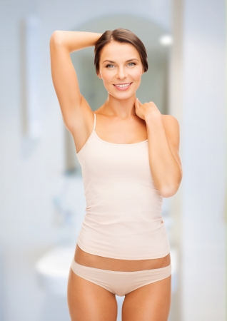 woman underwear: health and beauty concept - beautiful woman in beige cotton underwear
