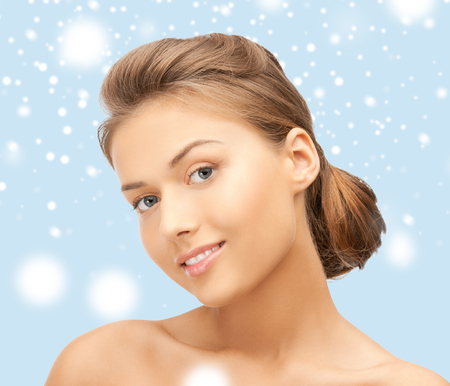 health and beauty concept - clean face of young beautiful woman photo