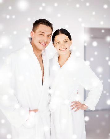health and beauty concept - couple in spa salon in white bathrobes Stock Photo - 22870381