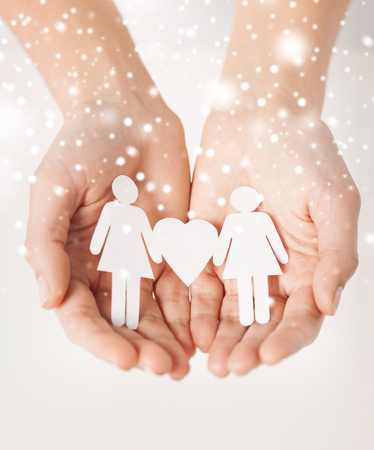 gay, lgbt, human rights concept - woman hands showing two paper women with heart shape photo