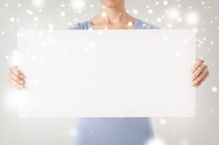 shopping, sale, advertisement, christmas, x-mas concept - woman hands showing white blank board photo