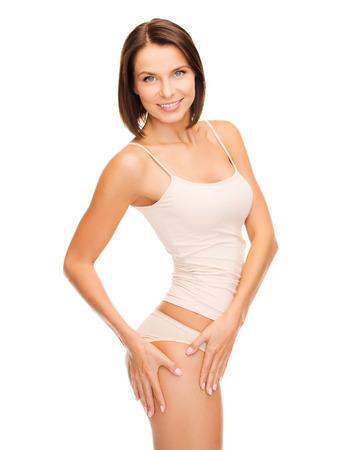 femme en sous vetements: Santé et beauté - femme en sous-vêtements de coton montrant concept minceur Banque d'images