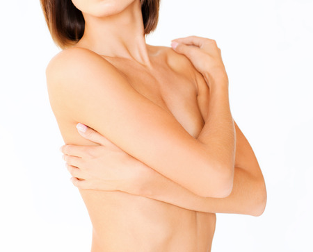 beauty breast: health, medicine, beauty concept - topless woman with perfect skin and hands over breast Stock Photo