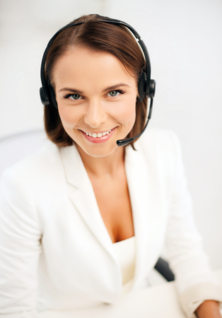business, communication and call center concept - female helpline operator with headphones Stock Photo - 22870769