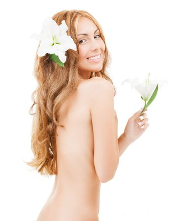 health and beauty concept - beautiful naked woman with white lily flower photo