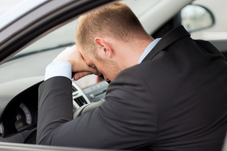 weariness: transportation and vehicle concept - tired businessman or taxi car driver
