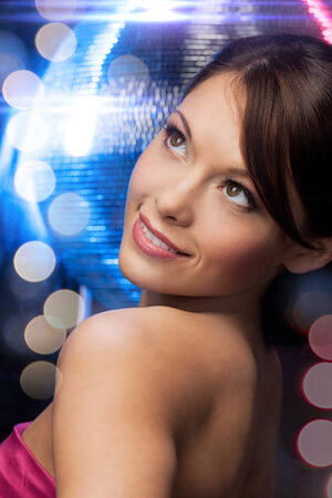 luxury, vip, nightlife, party, clubbing concept - beautiful woman in evening dress with disco ball photo