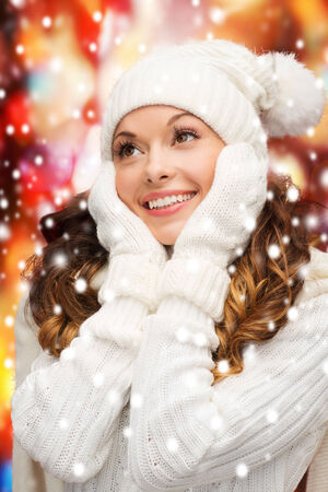 winter, people, happiness concept - woman in hat, scarf and mittens photo