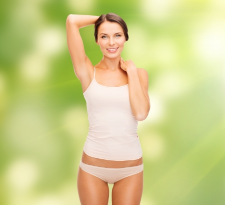 health and beauty, eco, bio, nature concept - beautiful woman in beige cotton underwear Stock Photo - 23287541