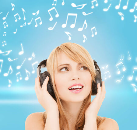 music and entertainment concept - happy girl with headphones photo