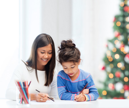 asian teacher: family, children, christmas, x-mas and happy people concept - mother and daughter drawing