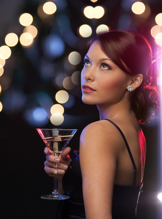 luxury, vip, nightlife, party concept - beautiful woman in evening dress with cocktail photo