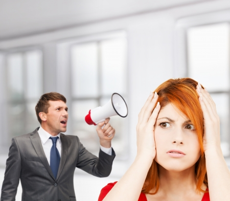 business, communication, hiring, searching, public announcement, office concept - buisnessman with bullhorn or megaphone and stressed woman photo