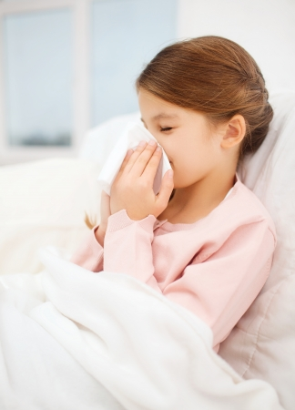 sniffle: healthcare and medicine concept - ill girl with paper tissue Stock Photo