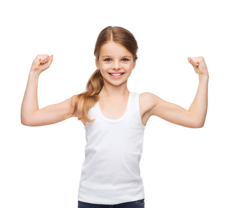 showing muscles: shirt design, stamina, strength, health, sport, fitness concept - smiling teenage girl in blank white shirt showing muscles Stock Photo