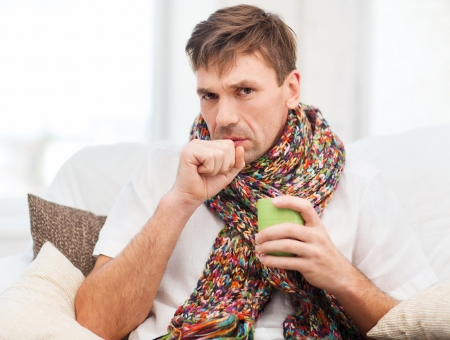 healthcare and medicine concept - ill man with flu at home Stock Photo - 23288686