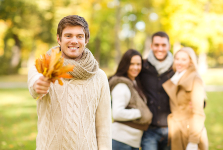 summer, holidays, vacation, happy people concept - group of friends or couples having fun in autumn park photo