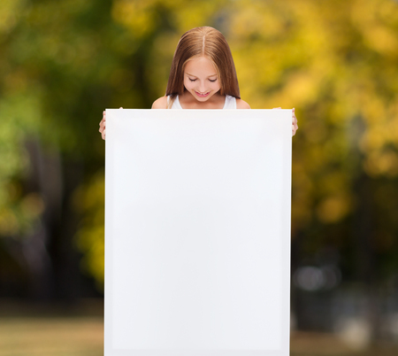 education and blank board concept - little girl with blank white board photo