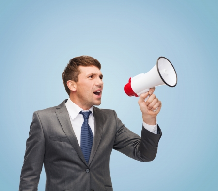 public speaking: business, communication, hiring, searching, public announcement, office concept - buisnessman with bullhorn or megaphone