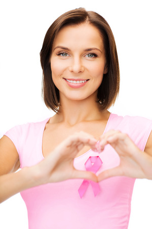 healthcare, medicine and breast cancer concept - woman with pink cancer ribbon photo