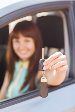 vehicle, rental, automotive concept - happy woman holding car key photo