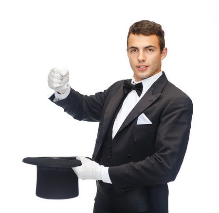 magic, performance, circus, show concept - magician in top hat showing trick with imaginary rabbit photo